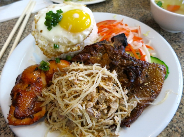 Steamed Rice with Grilled Chicken, BBQ Pork Chop, and Shredded Pork with a Fried Egg